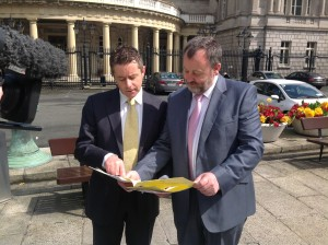 Senator Brian Ó Domhnaill with Senator Denis O Donovan scrutinising the Sea Fisheries and Maritime Jurisdiction (FixedPenaltyNotice) Bill 2013 before the launch of the bill this morning.